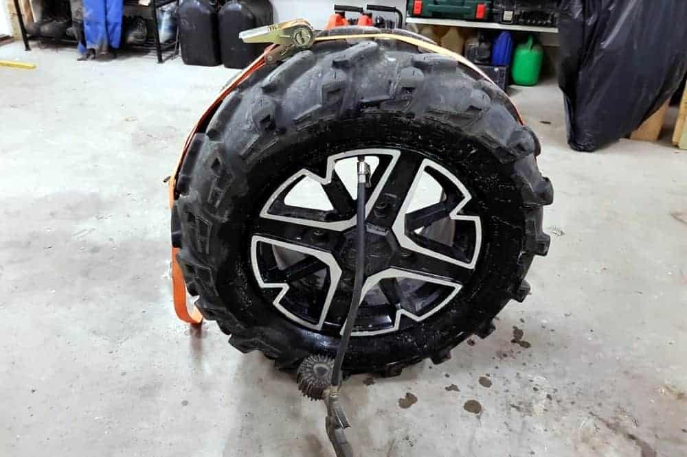 use ratchet strap to bead tire